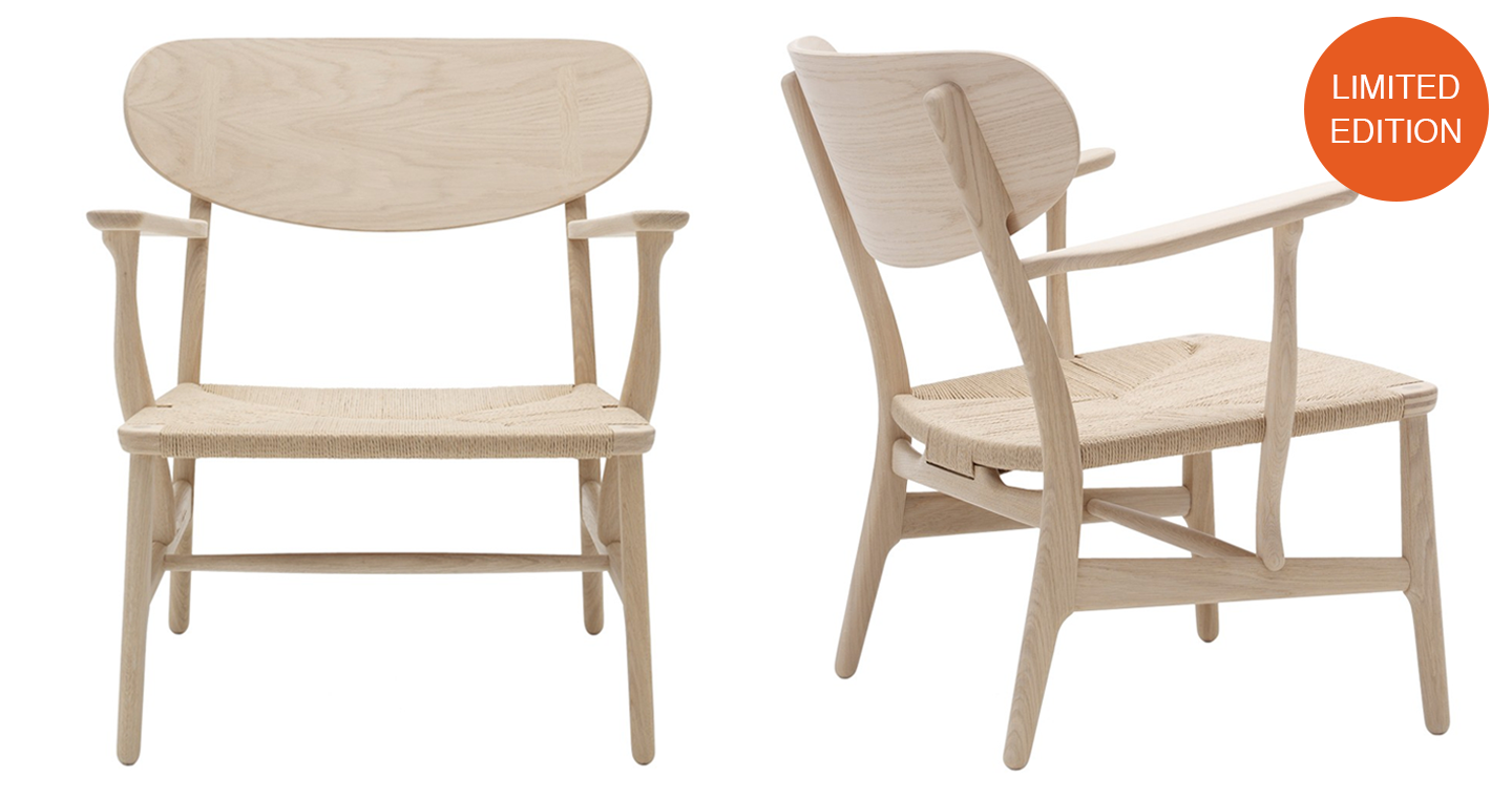 LIMITED EDITION - CH22 LOUNGE CHAIR SOAPED OAK INSCRIBED WITH HANS J. WEGNER'S SIGNATURE.